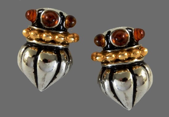 Dome shaped clip on earrings. amber art glass, silver tone metal