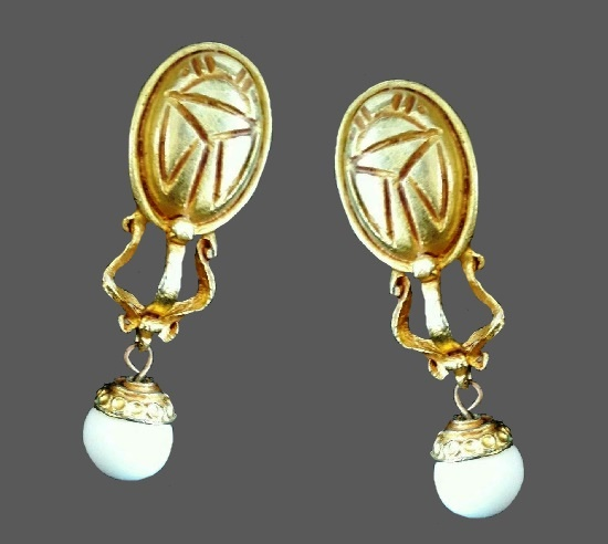 Egyptian revival scarab dangle clip on earrings. Gold Tone metal, plastic