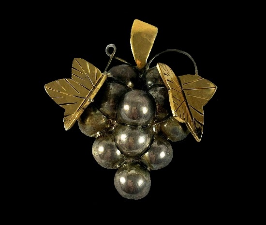 Grape cluster pendant brooch of silver and gold tone