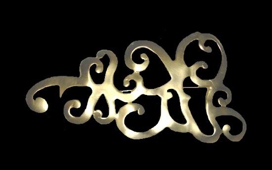 Haute Couture gold tone swirl brooch