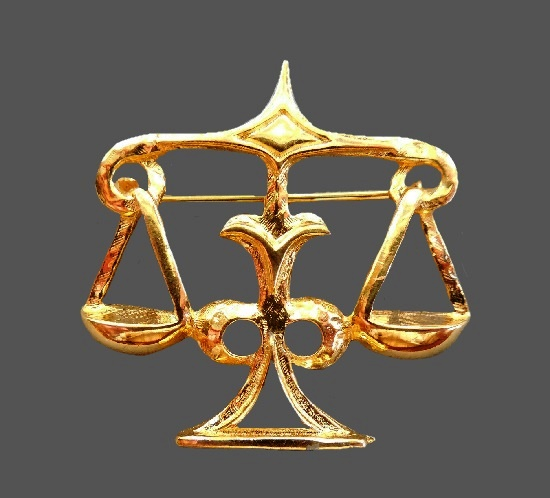 Libra zodiac sign brooch pin of gold tone. 1960s