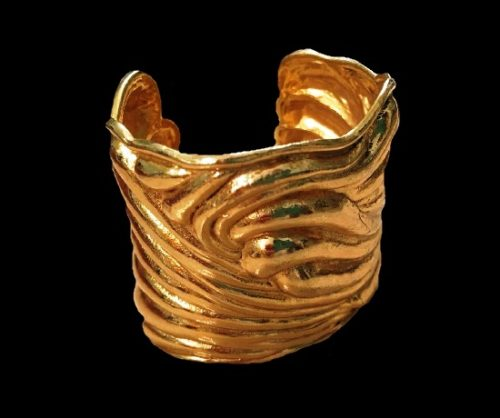 Massive sculptural gold tone bracelet