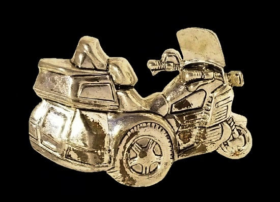 Motorcycle brooch p of gold and silver tone