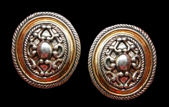 Oval shaped decorative ornament earrings of gold and silver tone