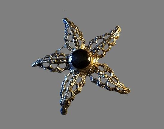 Starfish brooch. Marcasite, black cabochon
