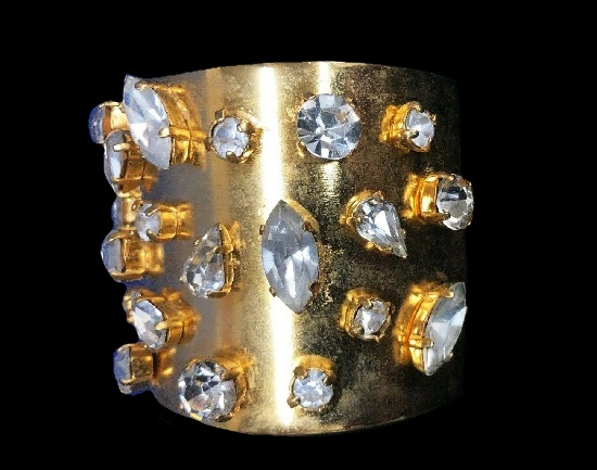 Statement cuff bracelet of gold tone with rhinestones