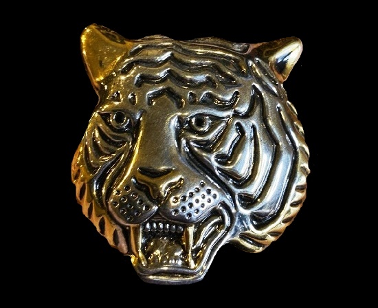 Tiger's head brooch of silver and gold tone