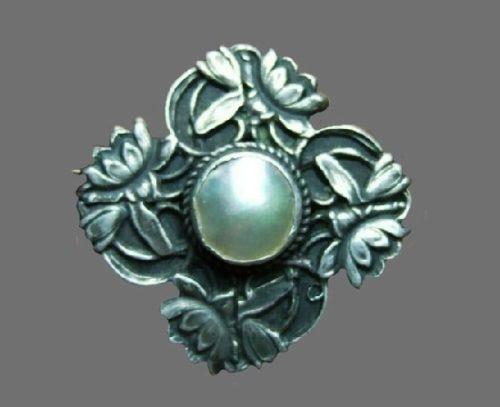 Antique sterling silver pearl brooch of floral design. 1909