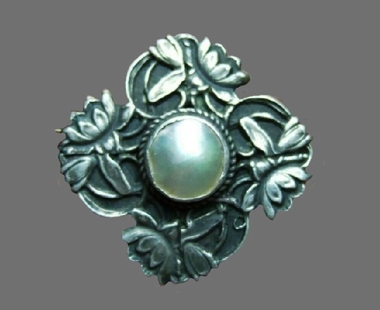 Antique sterling silver pearl brooch of floral design. 1909