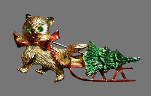 Bear cub pulling Christmas tree brooch pin. Gold tone metal, enamel, rhinestones