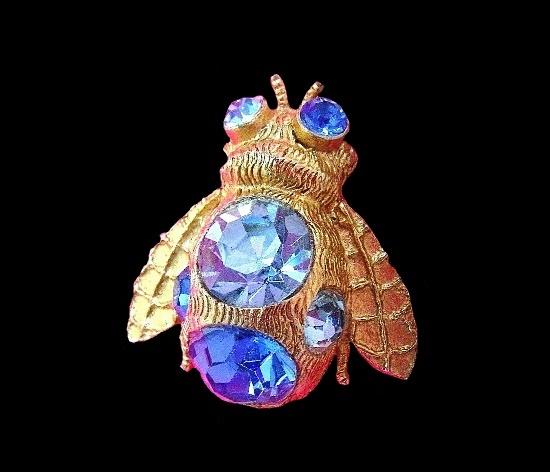 Bee brooch pin. Textured gold tone metal, blue rhinestones