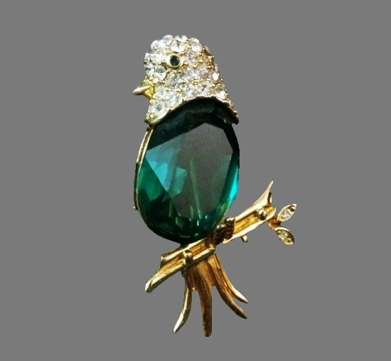 Bird brooch. Green glass cabochon, rhinestones, gold tone metal