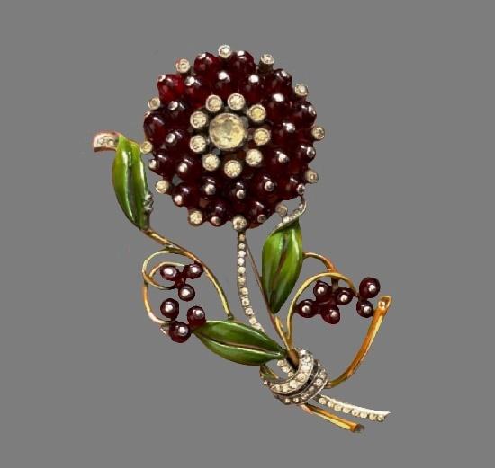 Black flower brooch pin. Gold tone metal, enamel, crystals. 1980s