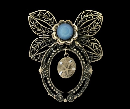 Blue cabochon face flower butterfly brooch with hanging charm