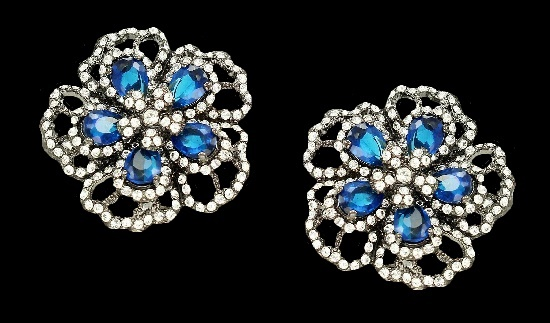Blue flower clip on earrings. Silver tone metal, blue and clear rhinestones