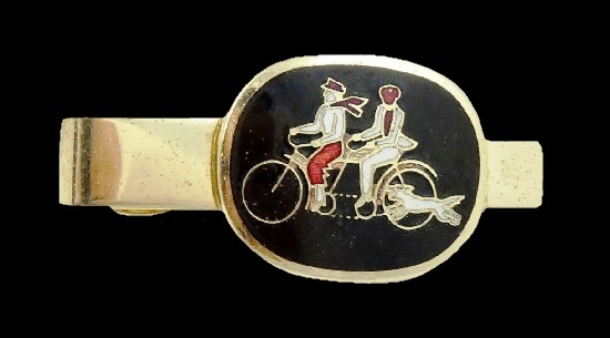 Cycling couple and a running dog tie clip. Gold tone metal, black and white enamel