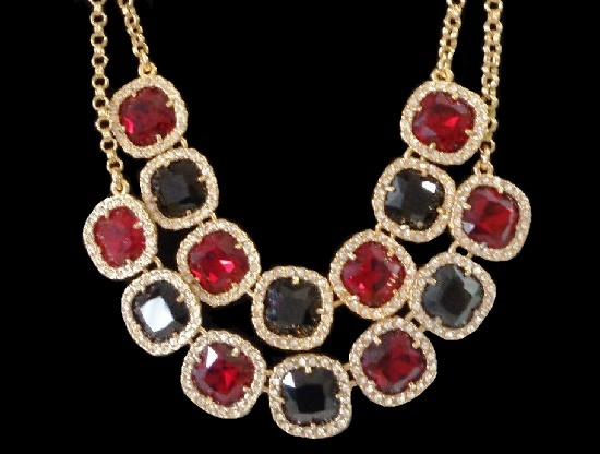 Double strand necklace. Gold tone metal, black and red glass cabochons