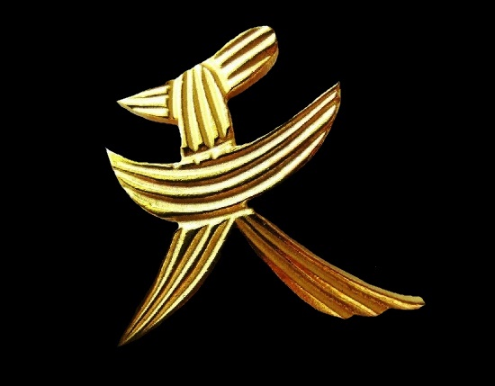 Dress clip of abstract design. Gold tone textured metal