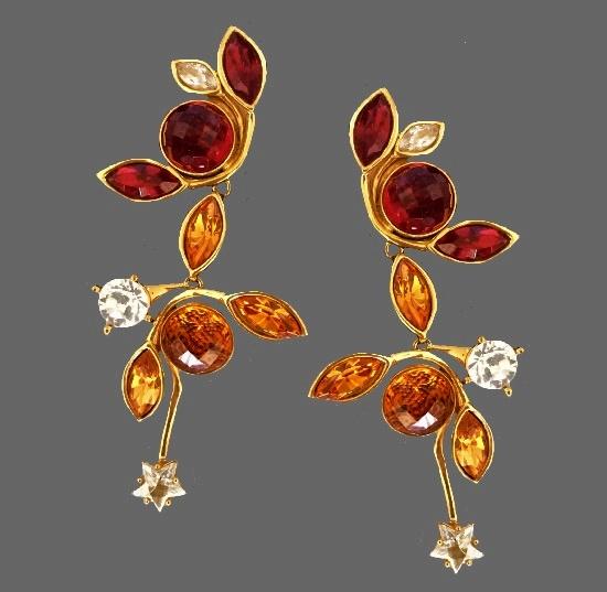 Drop dangling earrings. Gold tone metal, crystals