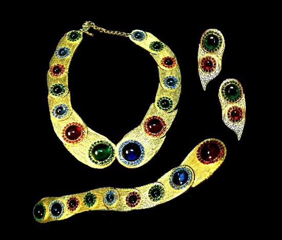 Egyptian revival Haute Couture necklace, bracelet and earrings. Yellow gold tone metal,glass cabochons of emerald green, sapphire blue and ruby red color