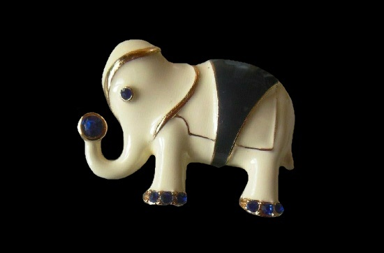 Elephant brooch. Gold tone alloy, white and blue enamel, blue rhinestone