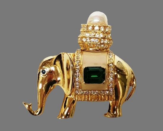 Elephant brooch. Gold tone, emerald green and clear rhinestones, faux pearl, enamel. 1980s