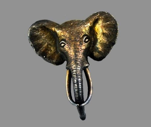 Elephant head brooch of copper and silver tone