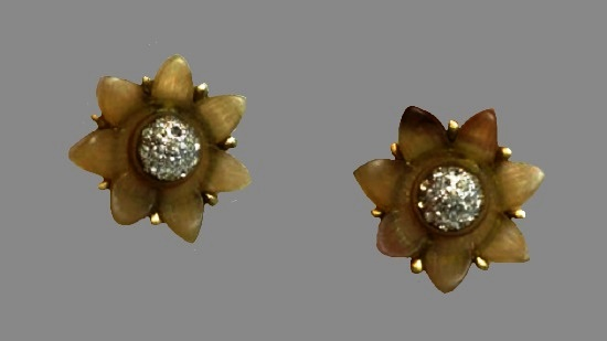 Flower clip on earrings. Gold tone metal, lucite, rhinestones. 1980s