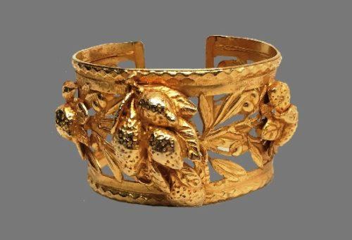 Fruit and leaf design gold tone bracelet