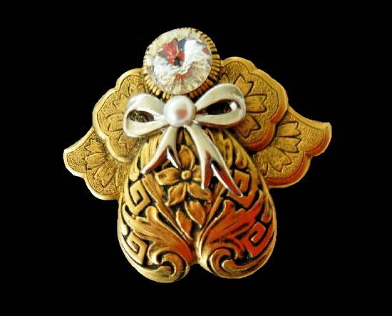 Gold tone angel with a bow brooch pin, rhinestone. 1995