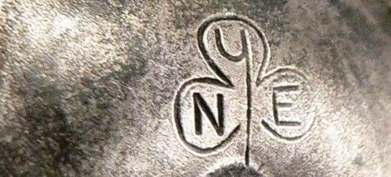 Initials NYE in a shamrock