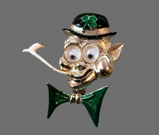 Leprechaun with pipe wiggly eyes brooch p. Gold tone alloy, enamel