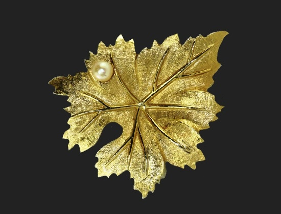 Maple leaf brooch. Gold tone textured metal, cultured pearl