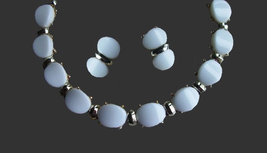 Molded lucite necklace and clip on earrings. Silver tone metal. 1960s