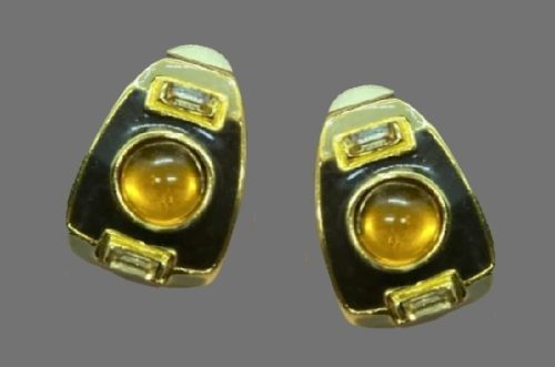 Orange glass cabochon clip earrings of gold tone, black enamel