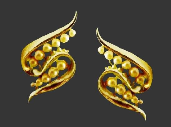 Swirl clip on earrings. Gold tone metal, faux pearls