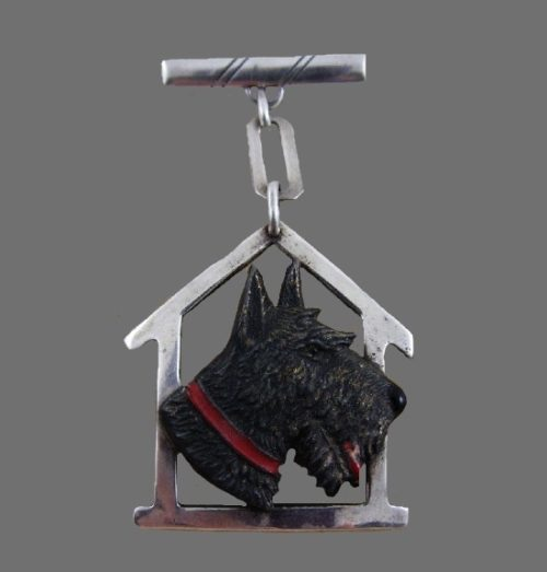 Scottie dog and the dog house. Sterling silver