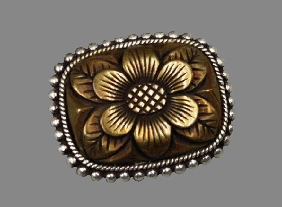 Textured bronze and sterling silver brooch of floral design