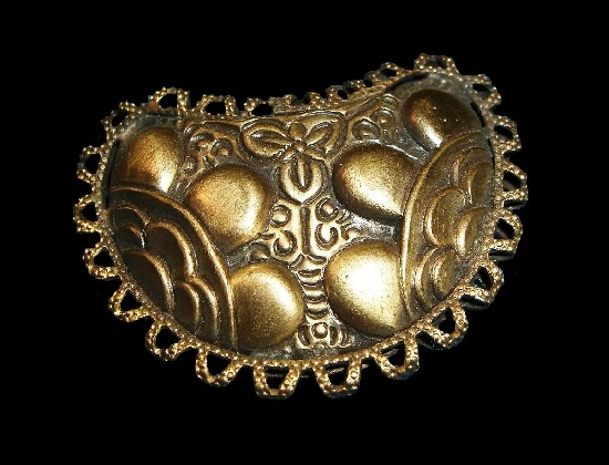 Textured gold tone brooch