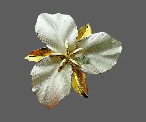 Three petal flower statement brooch pin. Silver, gold tone metal