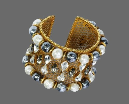 Wide cuff bracelet. Gold tone greed, faux white and black pearls, crystals. 1980s