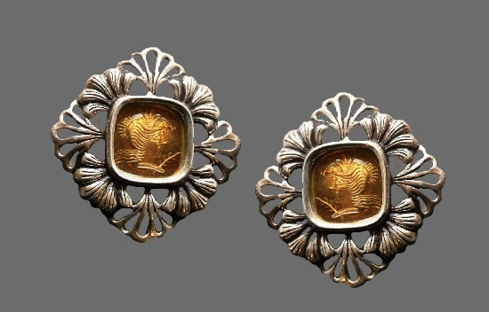 Woman Cameo floral design clip on earrings. Sterling silver, bronze, 1989