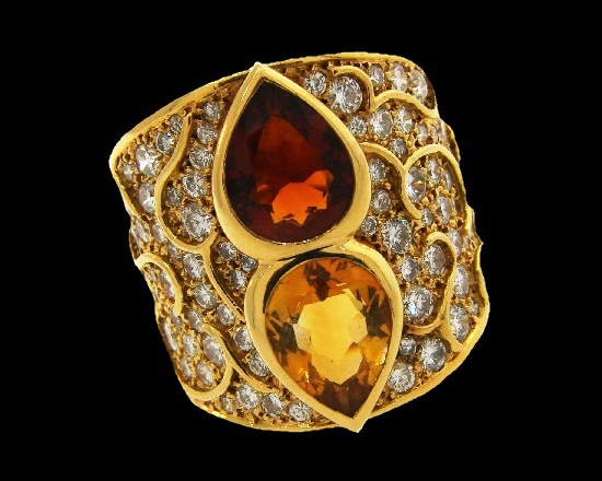 Yellow gold ring with citrine and topaz. 1985