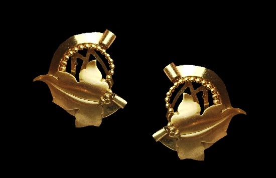 Gold tone shoe clips