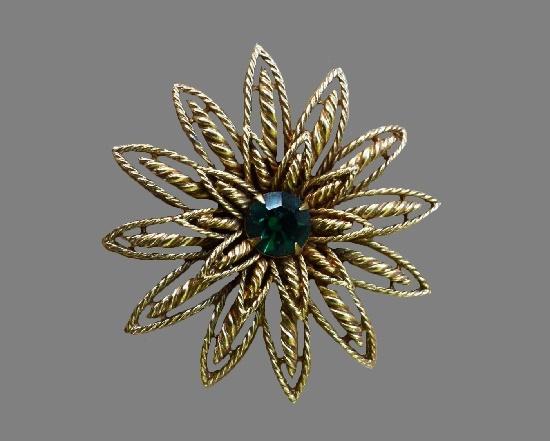 1960s flower brooch. Gold tone metal, green rhinestone