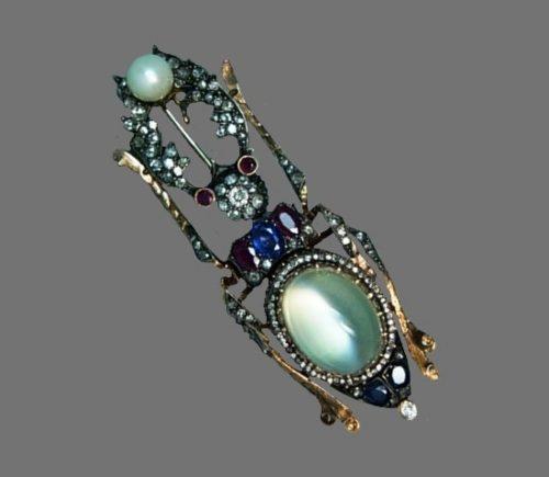 Beetle brooch. Gold, rubies, sapphires, diamonds, moonstone, pearls. A. Holstrem's workshop. Russia, St. Petersburg, before 1898. Length 8 cm