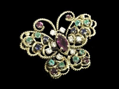 Butterfly brooch. 14 K gold, ruby, diamond, emerald