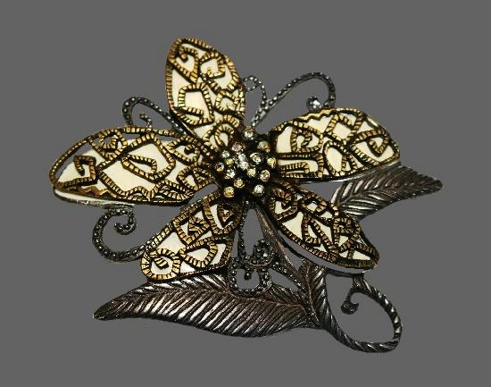 Filigree design flower brooch. Bronze and pewter tone metal, rhinestones