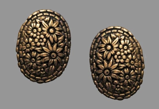 Floral design oval shaped textured bronze tone clip on earrings