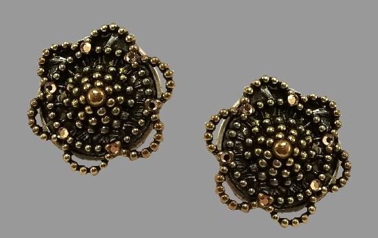 Flower design clip on earrings. Bronze and silver tone metal, rhinestones, resin